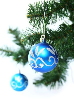 Two blue christmas ball in a christmas tree photo