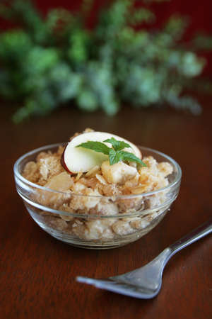 homestyle: Fresh apple crumble in a clear bowl with fork
