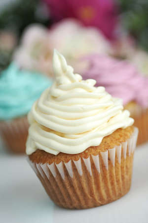 cup: Three cup cake with different icing.  Blue, pink and white Stock Photo
