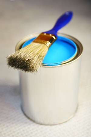 Blue painting in a container with a brush on top photo