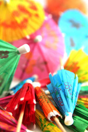 Lot of colorful paper umbrella for cocktails photo