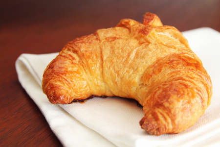 Fresh croissant on a ivory tableclothe for breakfast