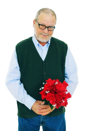 Senior man with a shy smiling holding a bouquet of red rose flowers on white background Stock Photo - 8968701