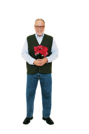 Senior man holding a bouquet of red roses flowers standing on white background Stock Photo - 8968657
