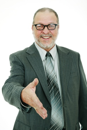Portrait of a successfull smiling senior man with glasses gesturing a hand shake Stock Photo - 8968787