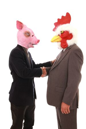 roster: Two business man with animals mask, pig and chicken shaking hands on a white background