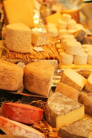 Different kind of french cheese display in a market Stock Photo
