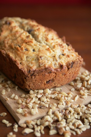 Warm and fresh nuts bread with nuts on a wood cutting board