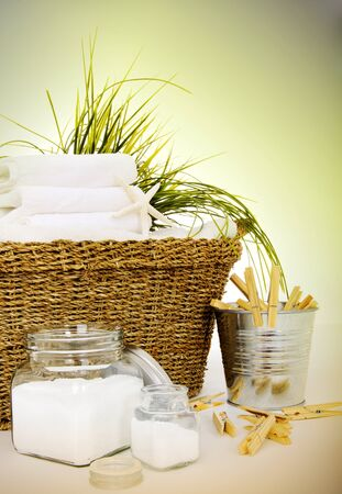 Fresh white towels with soap and clothespines for the laundry day