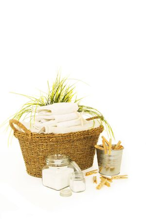 Fresh white towels with powder soap, and clothespines for the laundry day