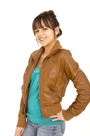 brown: Very nice teenager with leather jacket and smile on white background