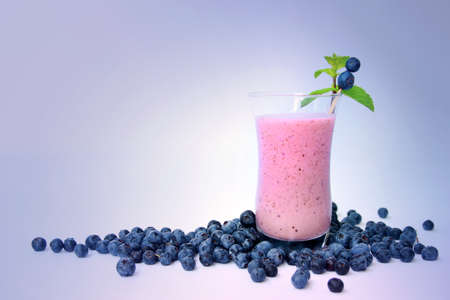 slurp: Blueberry smoothie with fresh blueberries on a purple background