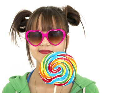 Smiling teenager holding a candies full of colors Stock Photo