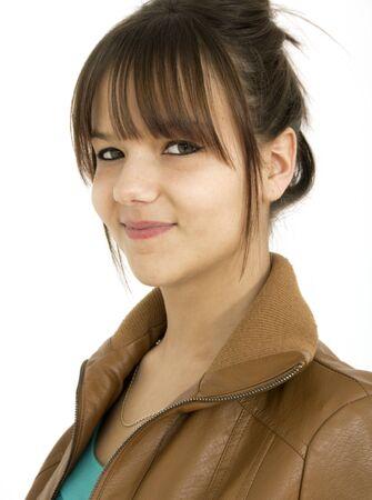 Beautiful teenager smiling on a white backgroun photo