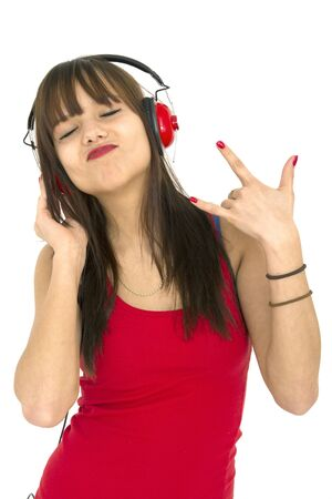 Teenager loving listening music with red headphone Stock Photo