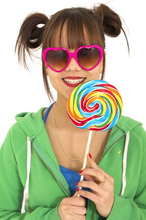 Smiling teen with heart shaped glasses and candies