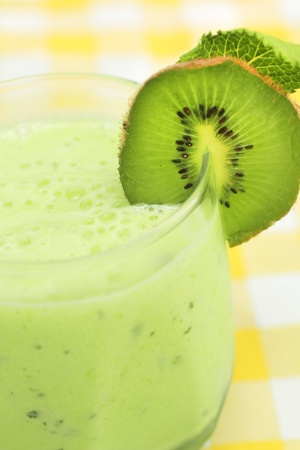 slurp: Close up of a green smoothie with fresh kiwi Stock Photo