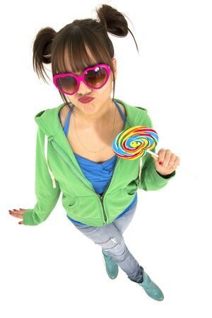 attitude girls: Teen with attitude holding a multicolorful cadies