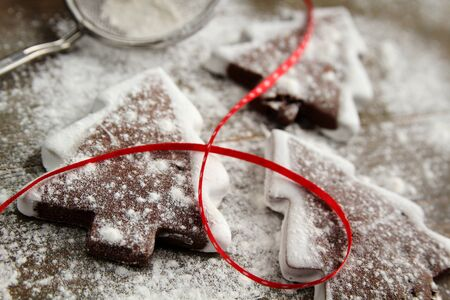 Christmas tree cookies with powder sugar and red ribbon Stock Photo - 11757439