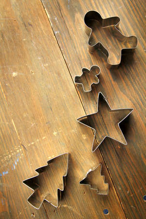 cutter: Five cookie cutter on a wooden table