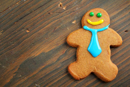 Business gingerbread with tie on a wooden table photo