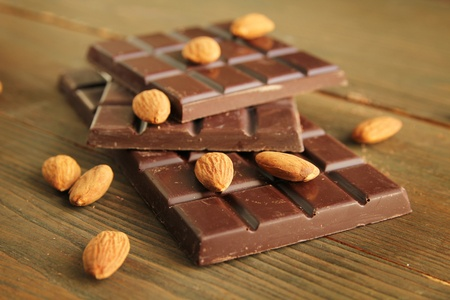 Dark chocolate with almond on a wooden table