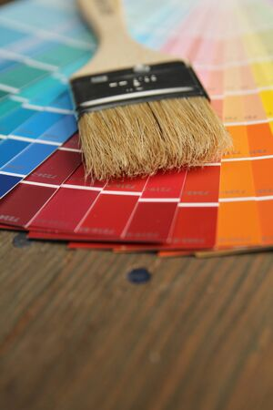 Different color palette and brush on a wooden surface Stock Photo - 12042321