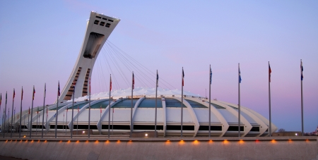 Olympic stadium in Montreal at dusk, Canada built in 1976 for summer Olympic and is currently the largest in Canada with is 1 million square meter.