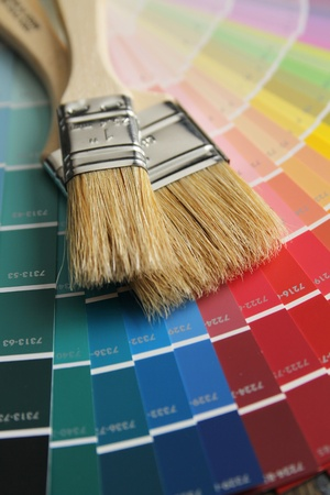Two brushes with wood handle on a color palette Stock Photo - 12042571