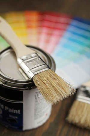 Brush on a little bucket with a color guide in background