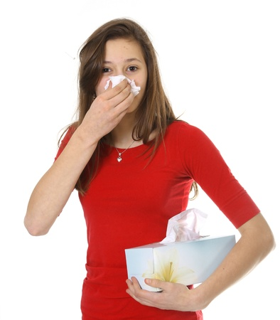 Teenager with red shirt have allergy or cold on white background photo