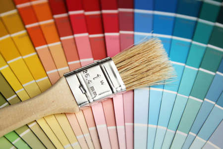 Brush with wood handle on a color guide Banco de Imagens