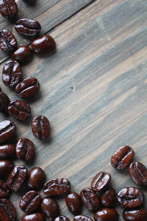 Coffee beans doing a frame on a wooden background Stock Photo - 12662157