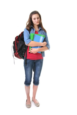 student girl unhappy to go to school holding books and having school bags Foto de archivo