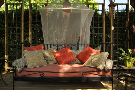 garden furniture: Nice couch full of cushions in a garden