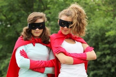 赤いマントと赤い手袋とスーパー ヒーローの女の子のスーパー チーム 写真素材
