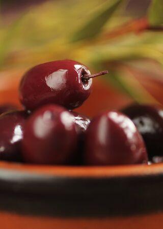 kalamata: Kalamata  olives into in a ceramic bowl