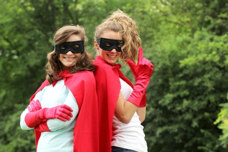 supergirl: Super team of super heros girl with red cape and red gloves