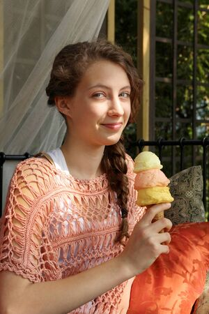 Teenager eating a 3 scoops ice cream cone photo