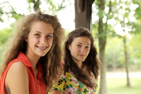 sweet sixteen: Portrait of two nice and smiling teenager girl Stock Photo
