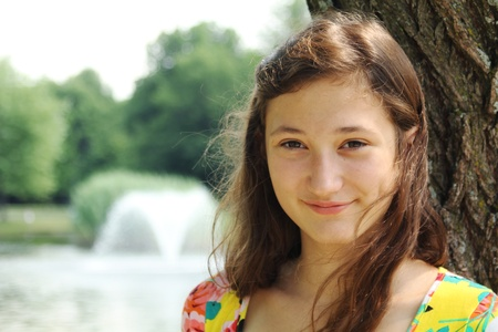 Portrait of a brunette teenager in a park Stock Photo