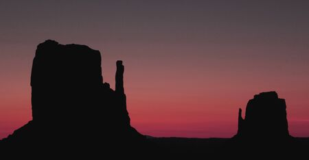 Redish sky over the mittens at Monument Valley photo
