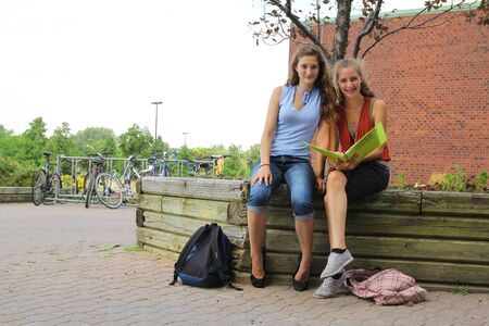 two young students at college after school