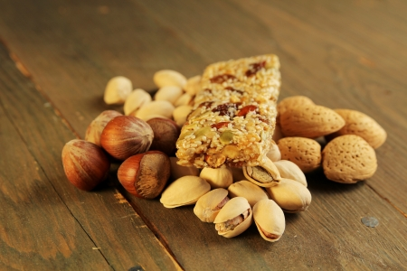 Granola bar on nuts  on a wooden table Stock Photo - 14814117