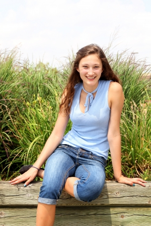 sweet sixteen: Portrait of a teenager smiling with a blue shirt Stock Photo