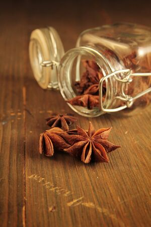 Star anise in a jar on a wooden table photo