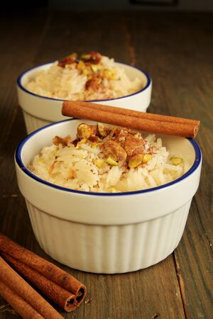 Duo of rice pudding with cinnamon stick on top Stock Photo