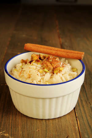 Rice pudding with cinnamone stick on top
