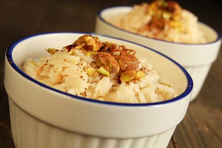Duo of rice pudding with cinnamon on top