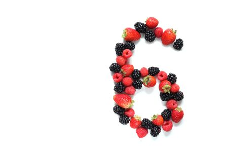 number six: Number six made from strawberry, raspberry and blackberry fresh fruits Stock Photo